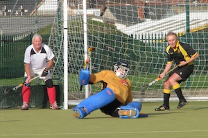 Chris Kalman saves from a Welsh penalty corner