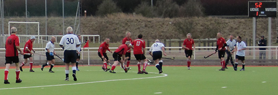 With 52 seconds showing on the clock, a phalanx of Welsh defenders repel Scottish Thistles