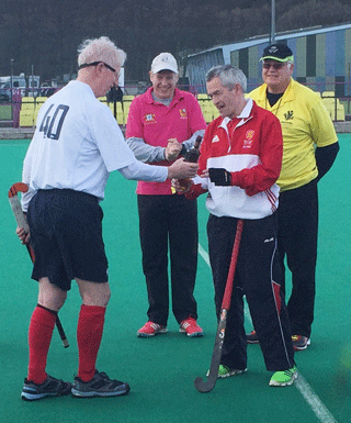 Scotland captain Ally Philip presents Scotland LX whisky  to England captain Brian Perryman