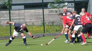 Ken Wilcox breaks through the Scottish defence                past Scottish GGM Captain David Cassell