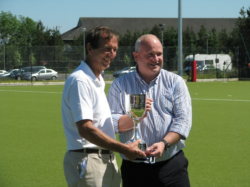 Stephen Stowell, England Grand Masters Captain, receiving the Linburn Trophy from Scottish Hockey Hon President Martin Boag